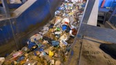 urban waste : A waste conveyor transporting a large amount of trash.