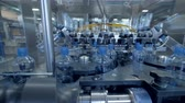 sterilized : Empty bottles fed to an automatic washing machine. Stock Footage