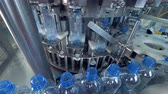 refill : Water bottles lifted up to an automatic filler. Stock Footage