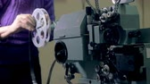 genre : Classic mechanical film projector being adjusted. Stock Footage