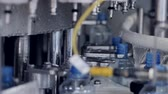 on line : Closeup view of water bottles entering a filling machine. Stock Footage