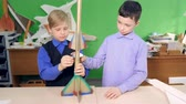 görev : Two kids are making a space rocket together Stok Video