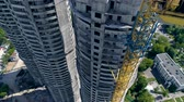 незаконченный : Three unfinished building towers in residential area. Стоковые видеозаписи