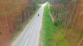 reliability : Drone video of a motorcyclist driving away. Stock Footage