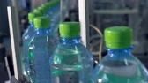 industrial revolution : Green-capped bottles moving  for packaging.