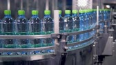 industrial revolution : Steady moving production line of water bottles. Stock Footage