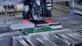 anakart : Motherboard elements production on modern equipment. 4K.