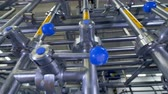 прерыватель : Dairy factory operation handles for water and waste control turned in different positions.