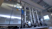 purified : Shiny stainless steel industrial factory pipeline equipment. Gas, oil, waterbio pipes.