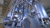 pharmaceutical factory : Pipelines, pumps, filters, gauges, sensors, motors. tank at industrial factory.