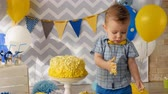 icings : A toddler boy with cake spots on his face. Stock Footage