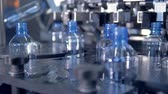 слот : Fast moving PET bottles inside factory production line. 4K.