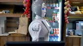 bakery shop : A robot works at the bakery counter.