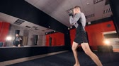 kickboxer : A boxer trains by himself near a gyms mirror. Stock Footage