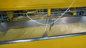 coagulation : Automatic steel stirrers prepare milk for cheese-making.
