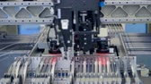 моторизованный : Robot installing electronic components and chips on circuit board. 4K.