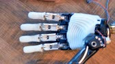 prototype : Humanoid humanlike arm at engineers workplace. 4K. Stock Footage