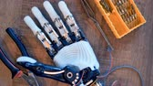 prototype : Cyborg arm at engineers desk. 4K. Stock Footage