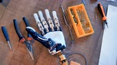 prototype : Engineers workplace with real cyborg humanlike hand. 4K. Stock Footage