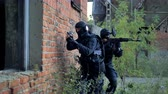 airsoft : Two swat soldiers check an old brick building during the anti-terrorist operation. 4K.