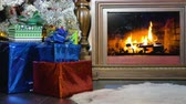 presentes : Christmas presents beside a burning fireplace. Christmas background.