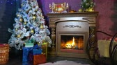 presentes : New year background. A warm fireplace with a view on a Christmas tree during new year night. Vídeos