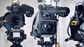 macro shooting : Three different video cameras and one of them blurred.