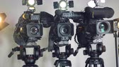 stabilita : Professional video cameras on adjustable tripods.