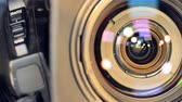 kruhy : A macro view on a camera lens and a zoom button.