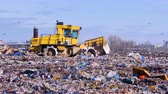 aterro : Waste, garbage, dump, rubbish 4K. A landfill compactor working at a lanfill site.