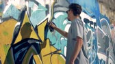 grafiti : A graffitist freshens up the picture.