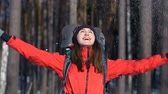 throws up : Laughing young girl throws snow up.