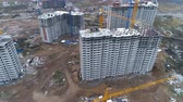 незаконченный : A camera moving away from unfinished apartment buildings.