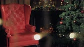 presentes : Christmas fireplace. Santa Claus chair near Christmas tree. 4K.