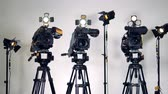 stabilizer : A zooming out shot on three cameras and lighting equipment. Stock Footage