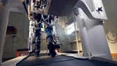rehabilitate : A lower body exoskeleton treadmill being used. Stock Footage