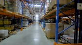 inventário : A horizontal view on several aisles of warehouse racks.