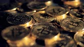 zaměřen : Many physical bitcoins under unfocused light shown in detail.