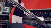 folding machine : A press brake with pneumatic front support bends stainless steel.