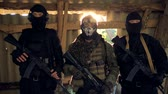 swat : Three fighters wearing tactical gear demonstrate their rifles. Stock Footage