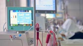 intensive : Medical screen displays patients medical parameters: pulse, blood pressure, temperature. Stock Footage