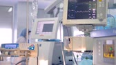 electrocardiograph : Medical device ecg monitor in surgery shows patients parameters - heartbeat, blood pressure. Stock Footage