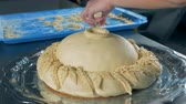 bitirme : Baker finishes to decorate a round loaf with pieces of dough, close up Stok Video