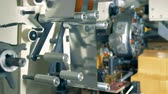coil : Close up of the structure of the machine for wrapping sweets up Stock Footage