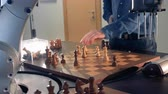 szachy : Artificial intelligence, robot chessplayer playing chess with a man. 4K. Wideo