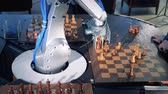 cyber : Close-up robot chessplayer playing chess with a himan.