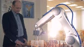 rivalry : Robotic Arm playing chess with a professional chess player. Stock Footage