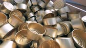 örgütlü : Top view of a pile of empty tin cans laying in a wooden container. 4K.