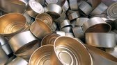 conservado : Close up of a stack of empty tin cans laying in a wooden box