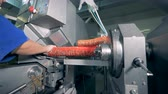 frankfurters : A person is allocating packaging on a factory machine which is filling it with meat Stock Footage